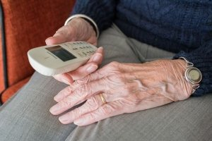 elderly-holding-phone
