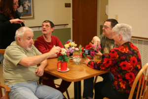 group of seniors sitting at a table