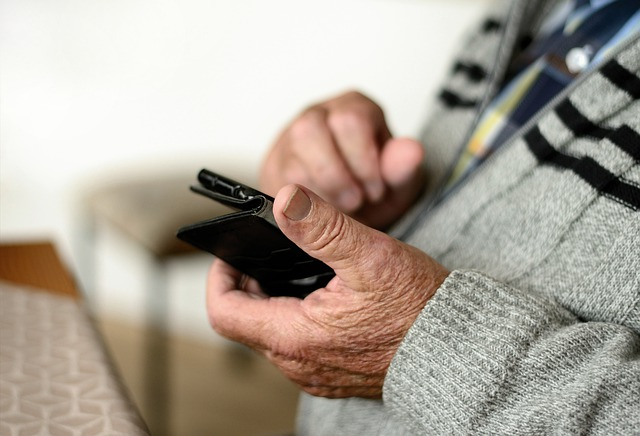 elderly man on his cell phone