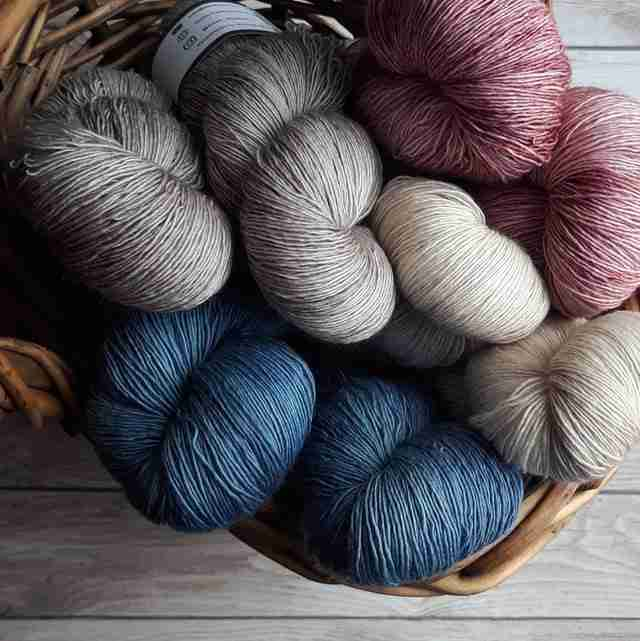 different color yarn in a basket